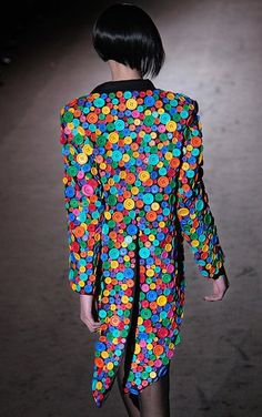 A jacket with stunning tails that makes eye-popping use of buttons. By the late Patrick Kelly, who knew the value of a good button.from the Idiosyncratic Fashionistias blog