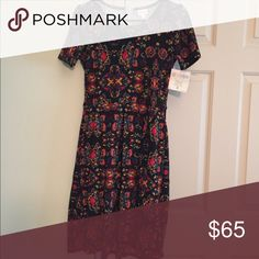 Small Lularoe Amelia dress. BNWT Gorgeous Black floral design Lularoe Amelia size small, BNWT. I lost weight and now this doesn't fit my chest area the way it should. Fits size 6-8 comfortably and has some stretch. Would be perfect to wear in the fall/winter with some tights and boots. LuLaRoe Dresses Midi