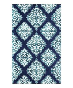 Take a look at this Momeni Rugs Navy Arabesque Hand-Hooked Rug today!