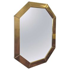 Brass Clad Octagonal Mirror by Sarreid   From a unique collection of antique and modern wall mirrors at https://www.1stdibs.com/furniture/mirrors/wall-mirrors/