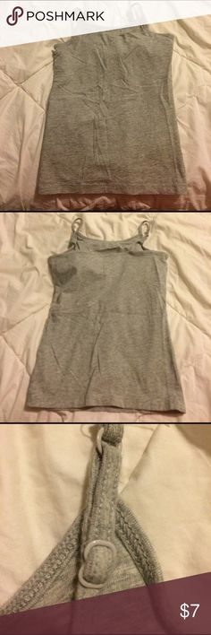 Girls gray cami Girls gray cami. Has a built in bra and adjustable straps (see picures). Barely worn. Great for layering! Size 10 Shirts & Tops Camisoles