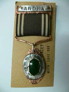 Honour badge 'Aroha'  Stacey Noel    Pounamu, copper, silver and cotton brooch.
