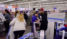 1:35AM on Black Friday -Shoppers buying flat screen televisions at the Walmart Supercenter in Coventry Rhode Island. November 17 2015. #BlackFriday #Walmart #Consumerism #BlackFridaySale #Thanksgiving #Samsung #CoventryRI #PrincetonPhotographer #HuangMenders To see insider views and behind-the-scenes follow us on Instagram: http://bit.ly/HMPhoto1 Facebook: http://bit.ly/HMPFB Wordpress: http://bit.ly/HMWPress