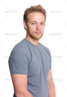 Young caucasian man ...  adult, attractive, background, beautiful, beauty, blond, blonde, blue, boy, bread, casual, caucasian, causal, clothing, confident, cool, european, guy, hair, handsome, happy, isolated, jeans, long, looking, male, man, model, one, people, person, portrait, pose, shirt, simple, slim, smart, studio, style, stylish, t-shirt, tee, wear, white, young, youth