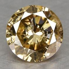 Champagne Diamond from Argyle Mine, Australia. Champagne, cognac and chocolate diamonds have been heavily marketed since it was discovered that Argyle mine has mostly brown diamonds, which were previously only used for industrial purposes. Diamond Art, Diamond Gemstone, Minerals And Gemstones, Rocks And Minerals, Gems Jewelry, Gemstone Jewelry, Jewellery, Diamond Jewelry, Colored Diamonds