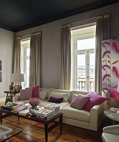 Love the textured wall and the long drapes #livingroom
