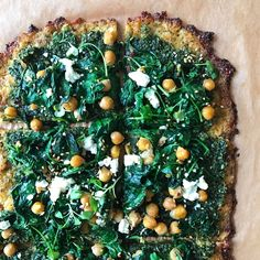 For this Pi Day, we recreated my friend Nancy's (of Urban Kitchen Apothecary) Green on Green pizza using a homemade cauliflower crust.  Cauliflower Crust with Sautéed Kale & Chickpeas, Basil-Pumpkin Seed Pesto, Goat Cheese, Feta Cheese, topped with a fennel-sesame seed-salt mix and arugula micro-greens to finish. It's an AMAZING combination of flavors!