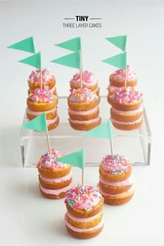 Tiny three layer cakes.