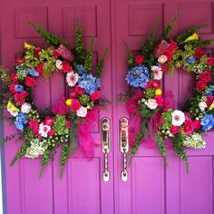 Some brightly colored front doors and colorful wreaths.  No better way to say -Welcome!