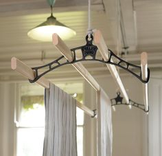 Our deluxe pulley maid ceiling clothes airer laundry drying rack with black cast iron rack ends. Suspended from the ceiling its operated using a pulley system.