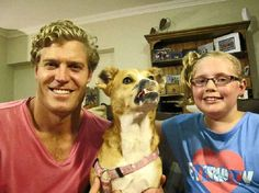 Bondi Vet television host Chris Brown with India Davies and Poppy, who has left behind her life on the streets of Fiji and has a new home in Peregian Springs.