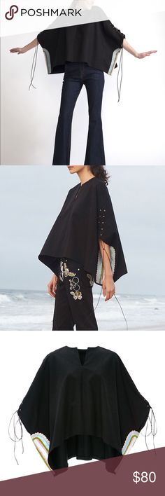 Cynthia Rowley embroidered cotton poncho Rendered in cotton, this Cynthia Rowley poncho features a v-neckline, threadwork embroidery, lace-up detailing along the sleeves, and a loose silhouette. Cynthia Rowley Tops