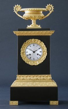 An Empire Gilt Bronze Clock - Charles Clark - Dealer in American Antiques
