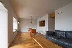 Completed in 2015 in Arakawa, Japan. Images by Kenichi-Suzuki, Ganko-sha . An oak-edged window providesa framed view ofthe living room within this Tokyo apartment, intended by Yumiko Miki Architects to recreate the effect of...