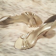 Champagne Colored Heels Leather champagnne colored heels with faux crocodile detailing along back heel & top straps of shoe. Height of heels - 3 inches ALDO Shoes Heels
