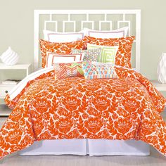 This vivid comforter rocks both a stylish damask pattern and a daring orange color.