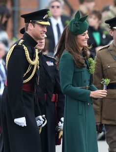 Catherine, Duchess of Cambridge and Prince William, Duke of Cambridge laugh as they present Shamrocks' during the St Patrick's Day parade at Mons Barracks on March 17, 2014 in Aldershot, England.
