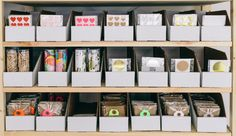 Knot and Bow: shop inventory, stored in white cardboard containers from Paper Mart