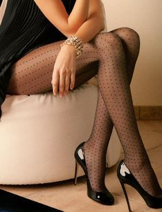 Shiny black heels with sheer black polka dotted pantyhose - great look!