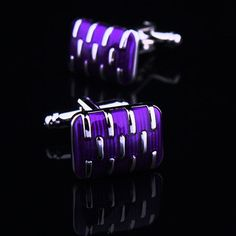 Distinguished cufflink set featuring purple cufflink front face on silver cup member; thin purple stripes and eleven silver clasps hugging the face. Stunning large front face brings out your debonair