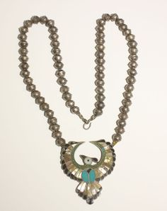 Vintage peyote bird necklace, with inlaid mother of pearl, onyx, coral and turquoise, with bench-made beads