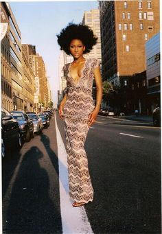 I <3 EVERYTHING about this pic.  Full-length gown + plunging neckline + big un-shaped #fro