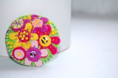 Felt pin brooch with colorful flowers.