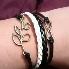 Beautiful Leather Charm Bracelet Brand new leather charm bracelet featuring leaves and infinity symbol. Comes with adjustable clasp and lobster claw fastener! Jewelry Bracelets