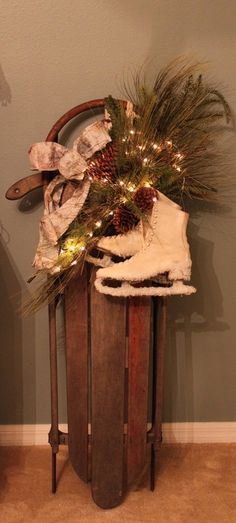 Old sled with a few added pieces. ♥ love the added snow on the skates! :))