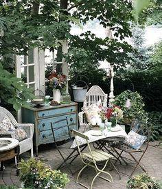 Blue dresser -- peeling paint, outdoor table