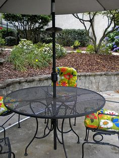 Small and large patio umbrellas need an umbrella base or stand to keep it stable.  It wasn't long before we found our table and umbrella tipped over.