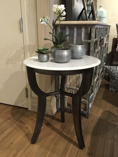 Marble and iron side table, 24 D x 28 H, $750