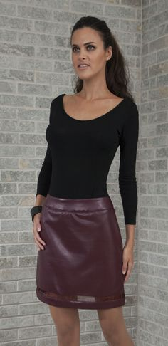 LAYLA: Maroon faux leather mini skirt with a maroon sheer mesh panel.