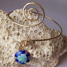 Armlet with Cloisonne Bead - Brass Armband - Brass Hammered  Swirl Armband Arm Torc - Upper Arm Cuff. $23.00, via Etsy.