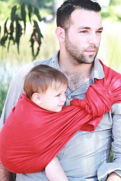 dad wearing his baby sling wrap
