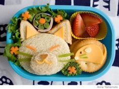 Not just for little people... how to make an easy cat lunch box using a sandwich, cheese, veggies, fruit and cracker