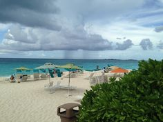 Beach at Atlantis, the Bahamas. See the dark lines in the sky? It was pouring down in torrents a few minutes later!