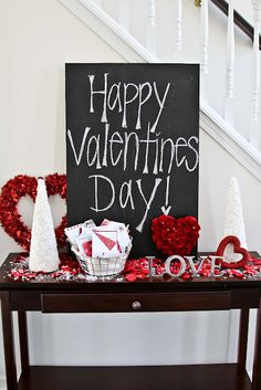 Valentines Day decor - front entry way... I like the chalk board, you can change the messages :)