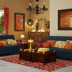 2- The colors in this room really stand out. There is a lot of red colors with blue accents. The coffee table and dresser are wooden to add some neutral coloring. There are candles and statues of Indian Gods to bring in a bit of their religion.
