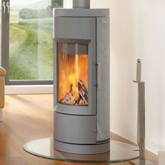 HearthStone Bari Wood Stove in Gray with Soapstone Panels Soapstone Wood Stove, Free Standing Wood Stove, Wood Pellet Stoves, Wood Pellets, Into The Woods, Fireplace Inserts, Curved Glass, Log Burner, Decoration
