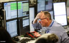 A trader reacts as he looks at financial data on computer screens on the trading floor at ETX Capital, a broker of contracts-for-difference in London, U.K., on Wednesday, Nov. 9, 2016. Donald Trump was elected the 45th president of the United States in a stunning repudiation of the political establishment that jolted financial markets and likely will reorder the nation's priorities and fundamentally alter America's relationship with the world. Photographer: Chris Ratcliffe/Bloomberg via…