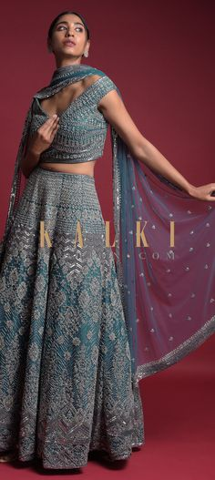 Teal blue lehenga choli in net hand embellished with sequins and cut dana embroidered heritage pattern all over. It comes with raw silk under layer. Blue Lehenga, Lehenga Choli, Sari, Wedding Function, Teal Blue, Indian Outfits, Blouse Designs, Gown, Two Piece Skirt Set