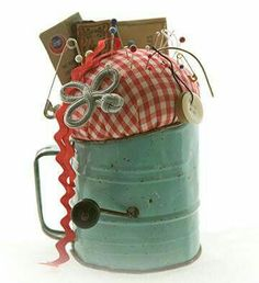 Cute idea for an old sifter...I just happen to have one!