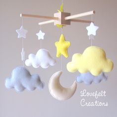 Baby mobile - cloud mobile - moon clouds mobile - yellow and gray mobile by lovefeltmobiles on Etsy https://www.etsy.com/ca/listing/206110995/baby-mobile-cloud-mobile-moon-clouds