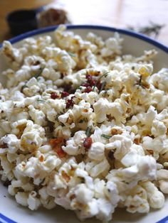 Pancetta and Rosemary Popcorn. That's right - this popcorn is topped with crispy pancetta and drizzled in pork fat. I dare you not to eat the whole bowl.