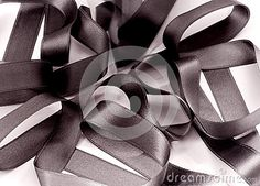 a closeup of a black ribbon isolated on white.