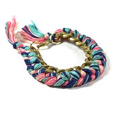 Braided chain. Large antique gold brass (aged) chain with a beautiful braid work, made of four different colors of 100% cotton embroidery thread.  It measures 7 inches long (from collapse ring to lobster claw clasp) and 1 inch wide.