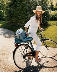 A Place in the Sun - The beauty executive rides out on an Hermès bike in her late grandmother's straw hat at her house in East Hampton.