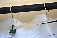 How to make easy DIY curtains for outdoors. DIY curtain rods for your pergola/outdoor entertaining area! Made with cable wire, super easy and inexpensive! from www.