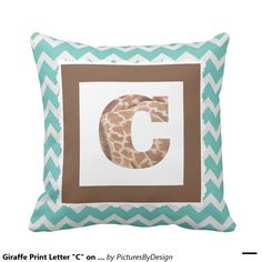 """Trendy pillow to show your """"wild side""""! Giraffe print filled LETTER C, framed in milk chocolate, on a mint & white chevron pillow."""